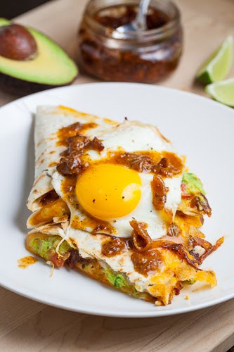 Bacon Jam and Guacamole Quesadilla topped with a Fried Egg and Bacon Jam Vinaigrette Drizzle