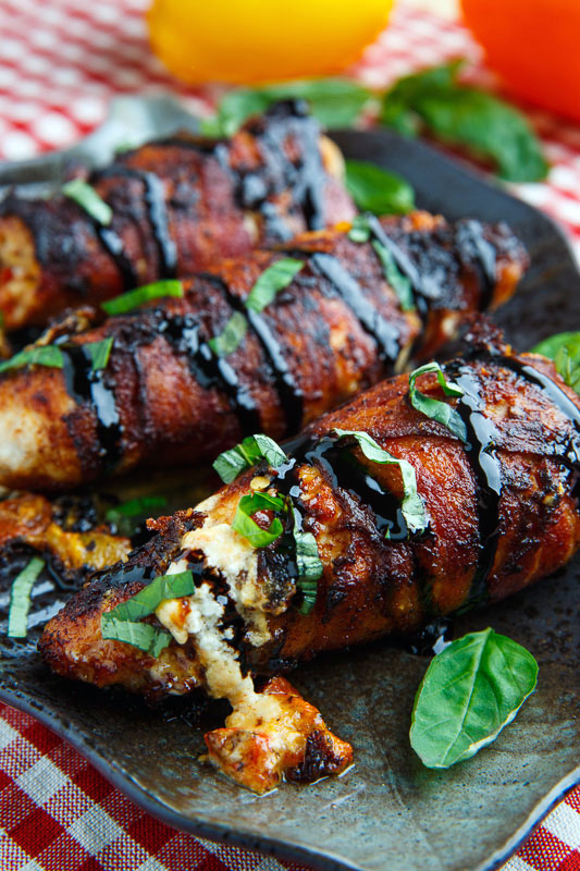 Bacon Wrapped Roasted Red Pepper and Goat Cheese Stuffed Chicken with Balsamic Drizzle and Basil