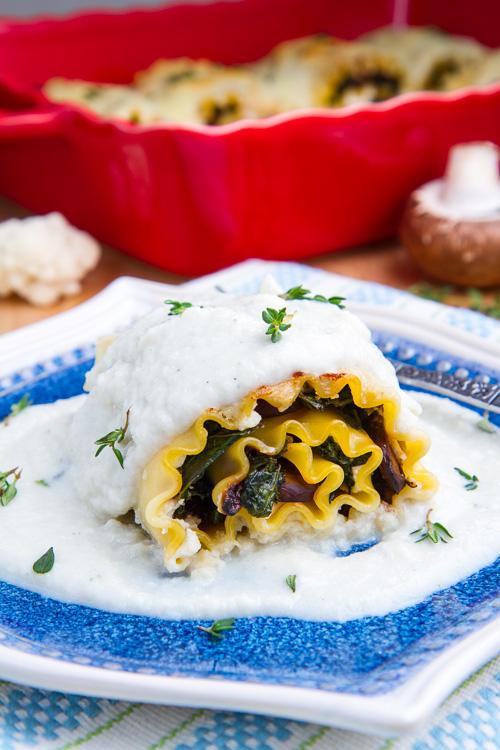 Mushroom and Kale Lasagna Roll Ups in Creamy Gorgonzola Cauliflower Sauce
