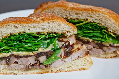 Porchetta Sandwich with Balsamic Caramelized Onions, Asiago Cheese and Arugula