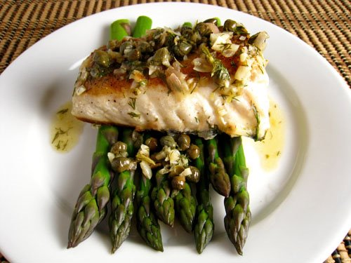 Halibut with a Lemon Dill Caper Sauce on Asparagus