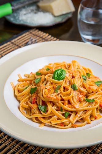 Roasted Red Pepper and Goat Cheese Alfredo Pasta Recipe : Sweet roasted red peppers in a creamy and tangy goat cheese alfredo sauce served over pasta.