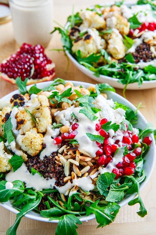 Roasted Cauliflower and Chickpea Quinoa and Arugula Salad with Almonds, Pomegranate and Feta in a Lemony Tahini Dressing