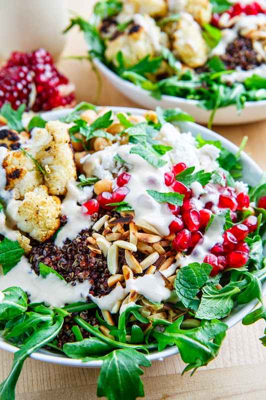 Roasted Cauliflower and Chickpea Quinoa and Arugula Salad with Almonds, Pomegranate and Feta in a Lemony Tahini Dressing