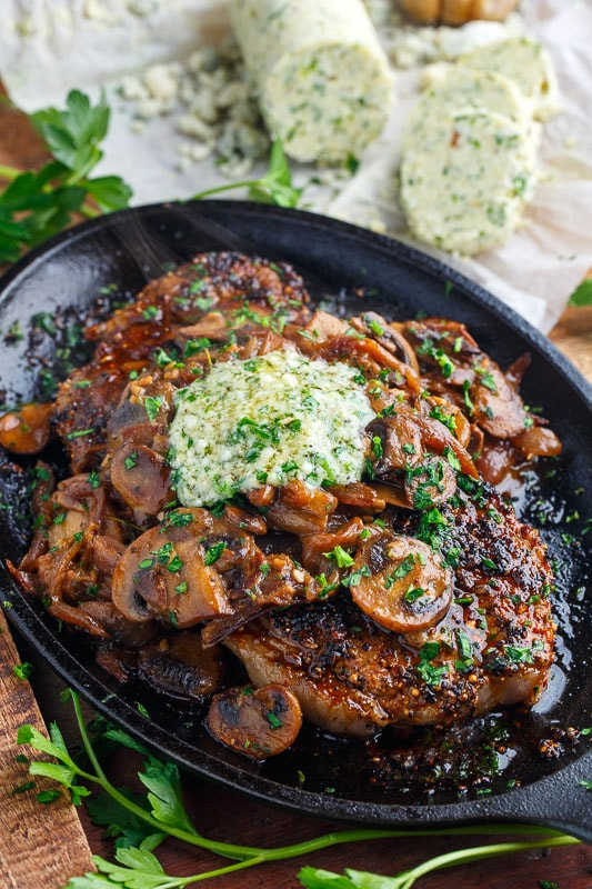 Pan Seared Steaks with Sauteed Mushrooms and Roasted Garlic Gorgonzola Butter