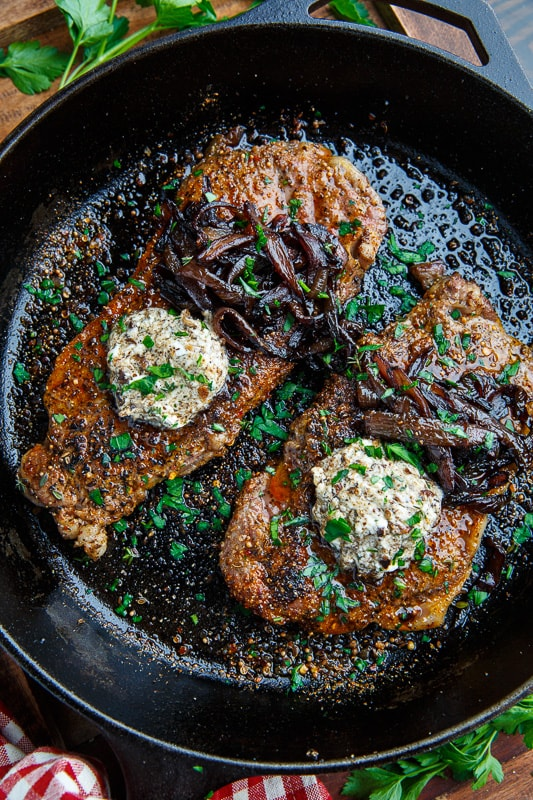 Pan Seared Steaks with Balsamic Red Onions and Roasted Garlic and Porcini Mushroom Goat Cheese Butter